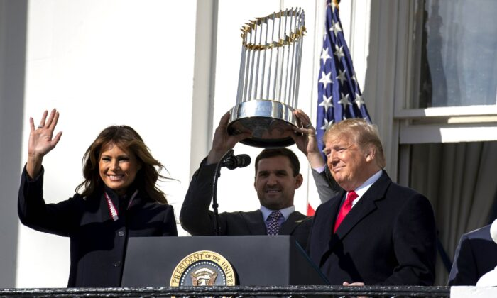 First Lady Melania Trump, Washington Nationals infielder Ryan Zimmerman, and President Donald Trump arrive for an event to honor the 2019 World Series Champion Washington Nationals, on the South Lawn of the White House, on Nov. 4, 2019. (Evan Vucci/AP Photo)