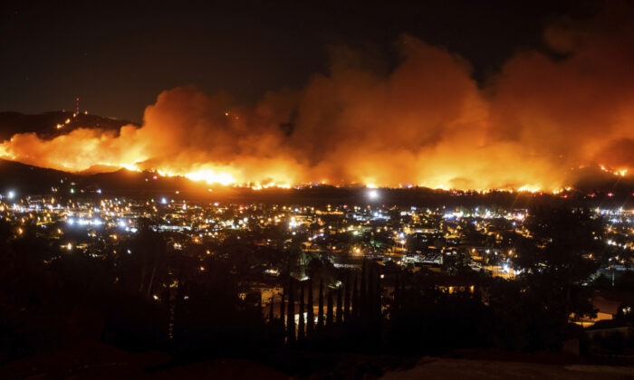 President Donald Trump on Sunday, Nov. 3 threatened to cut U.S. funding to California for aid during wildfires that have burned across the state during dry winds this fall. (Noah Berger/AP)