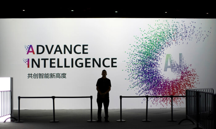 A security officer keeps watch in front of an AI (Artificial Intelligence) sign at the annual Huawei Connect event in Shanghai, China on Sept. 18, 2019. (Aly Song/Reuters)