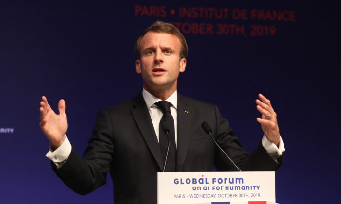 French President Emmanuel Macron delivers a speech during the Global forum on Artificial Intelligence (AI) for Humanity (GFAIH) at the Institut de France in Paris on Oct. 30, 2019. Macron is visiting China amid a push for Beijing to open its markets, despite festering trade disputes and weakened consumer spending. (Ludovic Marin/Pool via AP)