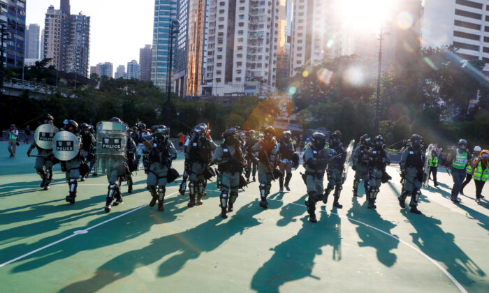 Police in riot gear enter Victoria Park as they disperse protesters in Hong Kong on Nov. 2, 2019. (Thomas Peter/Reuters)