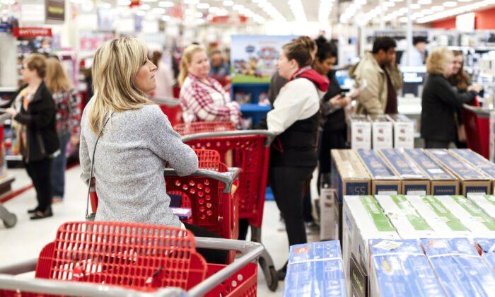 Shoppers wait in line. (John Minchillo/AP Photo)