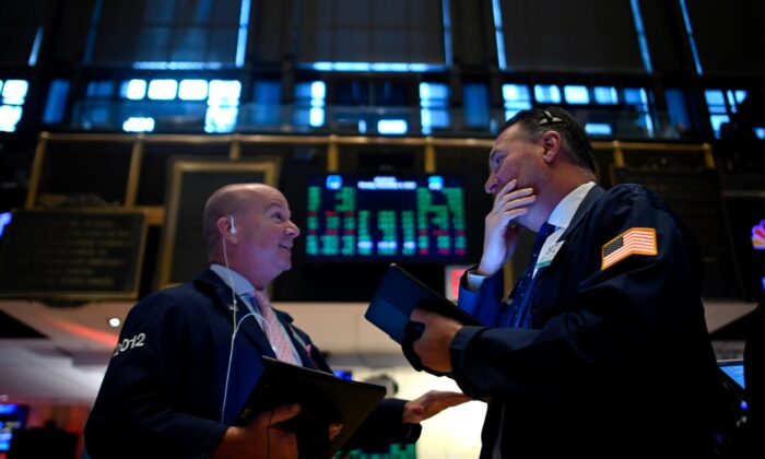 Traders work during the opening bell at the New York Stock Exchange (NYSE) at Wall Street in New York, N.Y., on Nov. 4, 2019. (Johannes Eisele/AFP via Getty Images)