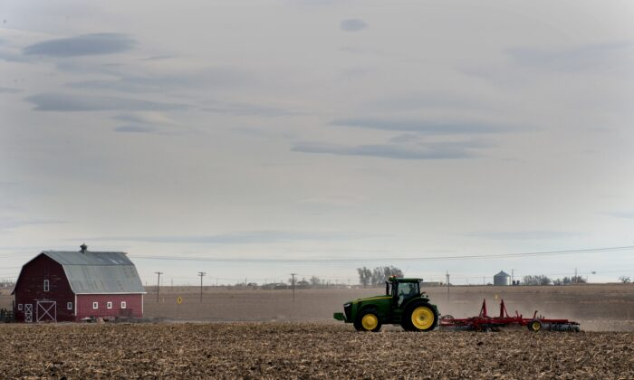 A farmer plows his fields in the small northeastern agricultural town of Eaton, Colorado, on Feb. 10, 2017. 