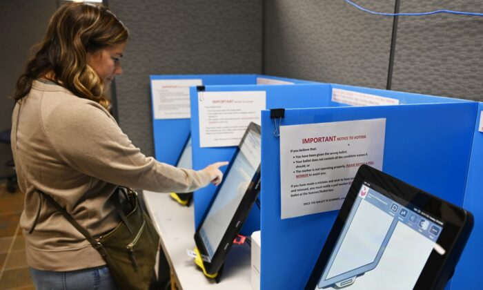 Courtney Parker votes on a new voting machine in Dallas, Ga. on Nov. 5, 2019. AP Photo/Mike Stewart