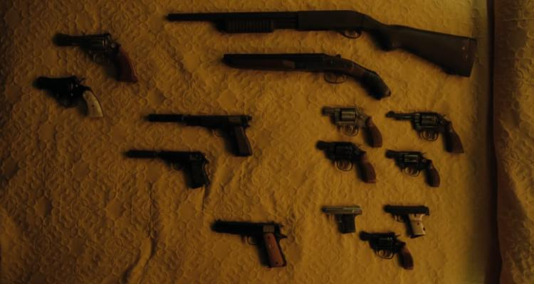 Lots of guns on a wall