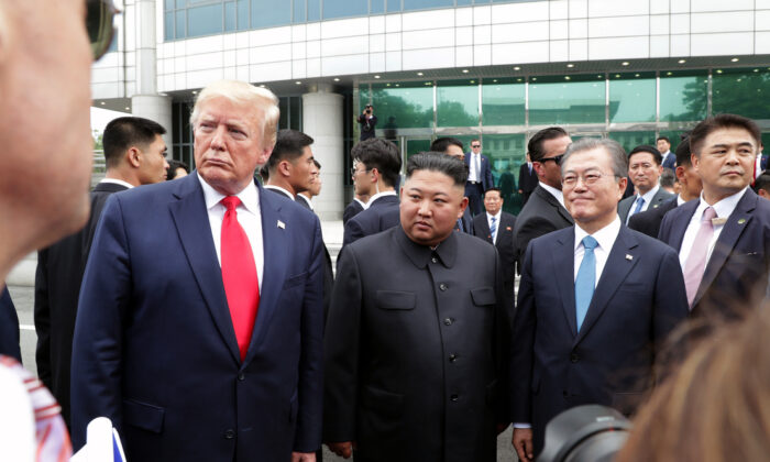 A handout photo provided by Dong-A Ilbo of North Korean leader Kim Jong Un, President Donald Trump, and South Korean President Moon Jae-in inside the demilitarized zone (DMZ) separating the South and North Korea in Panmunjom, South Korea on June 30, 2019. (Handout/Dong-A Ilbo via Getty Images)