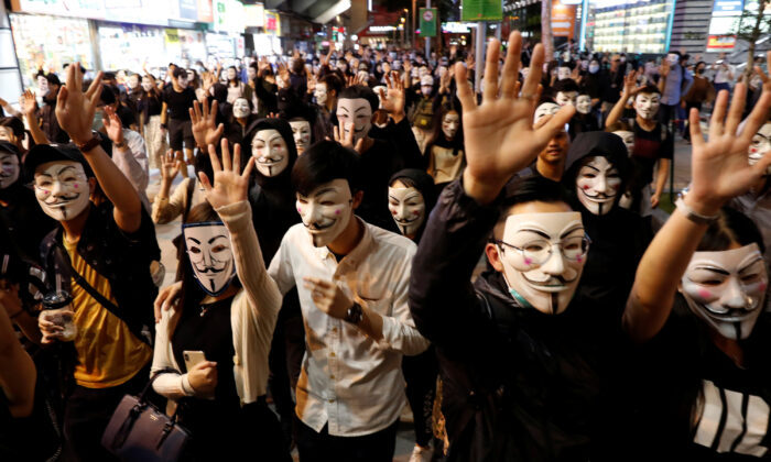 Protesters wearing Guy Fawkes masks attend an anti-government demonstration in Hong Kong, China on Nov. 5, 2019. (Kim Kyung-Hoon/Reuters)