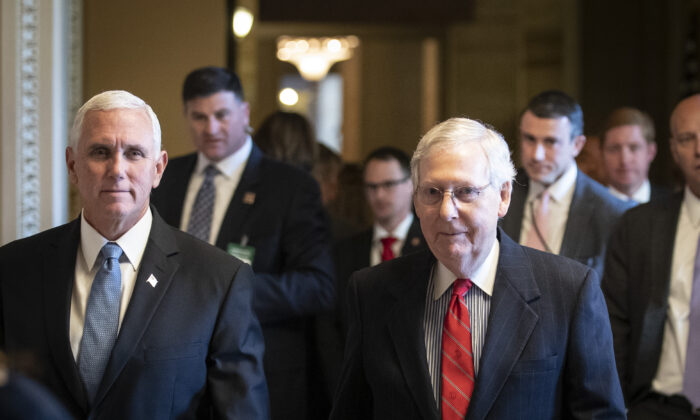 Vice President Mike Pence, left, and Senate Majority Leader Mitch McConnell (R-Ky.) walk to the Republican policy luncheon at the U.S. Capitol in Washington on Nov. 5, 2019. (Drew Angerer/Getty Images)