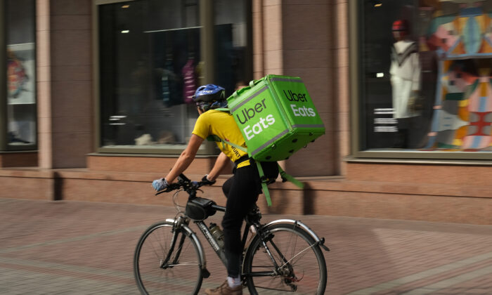 An Uber Eats food courier rides in the city center on Oct. 03, 2019 in Kiev, Ukraine. Uber has established itself firmly in Kiev and is now facing local competitors.  (Sean Gallup/Getty Images)