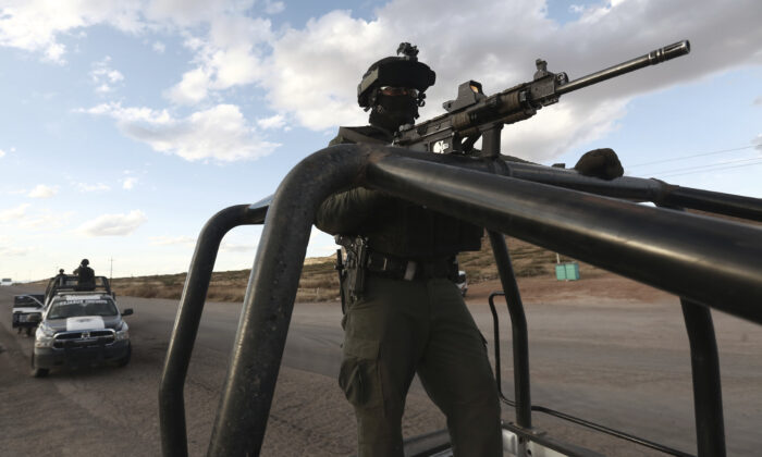 Chihuahua state police officers man a checkpoint in Janos, Chihuahua state, northern Mexico on Nov. 5, 2019, a day after nine Americans were killed by cartel gunmen. (AP Photo/Christian Chavez)