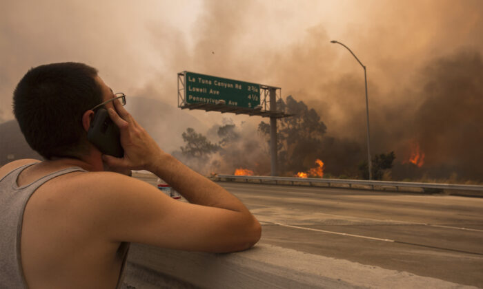 A man watches his house near the community of Tujunga in Burbank, Calif., on Sept. 2, 2017. (David McNew/Getty Images)