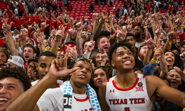 Members of the Texas Tech Red Raiders including guards Jahmi'us Ramsey #3 and Terrence Shannon #1, along with head coach Chris Beard, celebrate with fans after the college basketball game against the Eastern Illinois Panthers at United Supermarkets Arena on November 05, 2019 in Lubbock, Texas. John E. Moore III/Getty Images