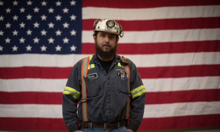 Donnie Claycomb, 27, of Limestone, W.Va., who has been mining for 6 years, stands in front of an American flag prior to an event with U.S. Environmental Protection Agency Administrator Scott Pruitt at the Harvey Mine in Sycamore, Pa., on April 13, 2017 (Photo by Justin Merriman/Getty Images)