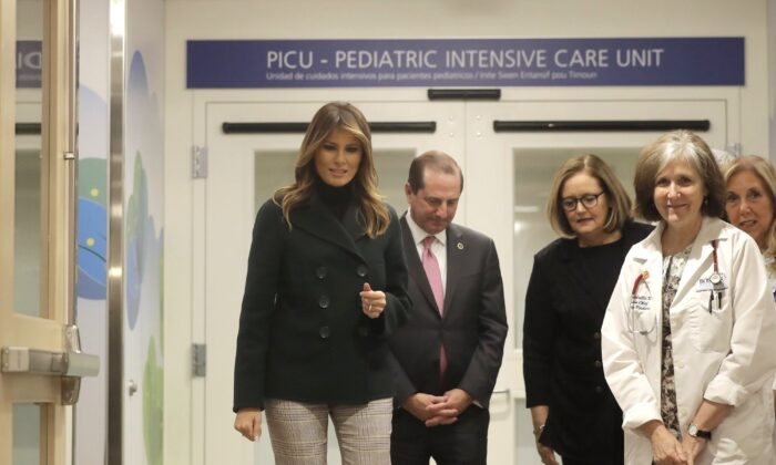 First Lady Melania Trump (L) walks with pediatrician Eileen Costello, front right, and Secretary of Health and Human Services Alex Azar, behind center left, during a visit to Boston Medical Center, in Boston, on Nov. 6, 2019. (Steven Senne/AP Photo)