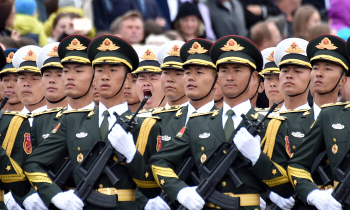 Chinese soldiers march during a military parade in a file photo. (Sergei Gapon/AFP via Getty Images)