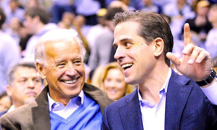 Vice President Joe Biden and his son Hunter Biden attend an NCAA basketball game between Georgetown University and Duke University in Washington on Jan. 30, 2010. (Jonathan Ernst/Reuters)