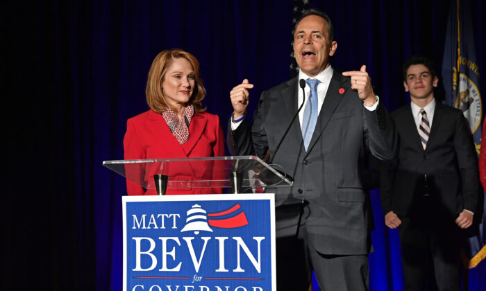 Kentucky Gov. Matt Bevin, right, and his wife, Glenna, speak to supporters gathered at a Republican Party event in Louisville, Ky. on Nov. 5, 2019. (Timothy D. Easley/AP Photo)