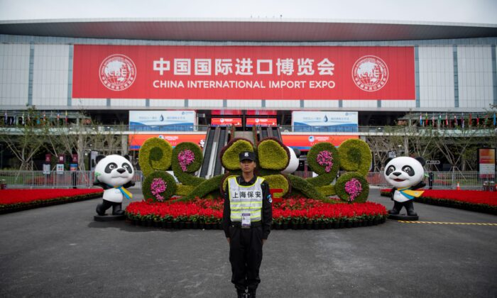A security guard stands at the entrance to the first China International Import Expo (CIIE) in Shanghai on Nov. 5, 2019. Chinese leader Xi Jinping vowed on Nov. 5 to open access to China's economy, while delivering a veiled rebuke to the Trump administration, as he kicked off an import fair amid growing foreign accusations that his government was backtracking on reform pledges. (Johannes Eisele/AFP via Getty Images)