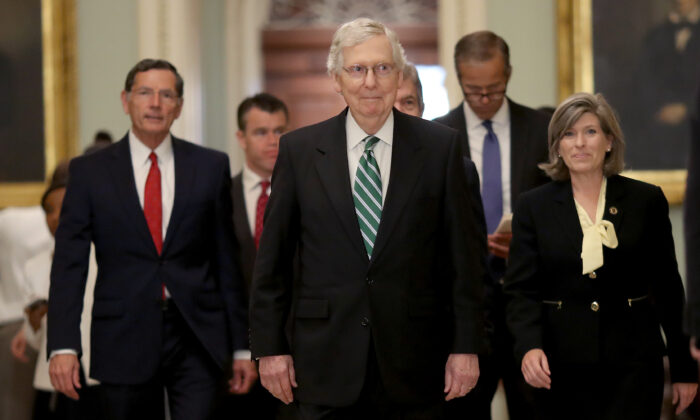 Senate Majority Leader Mitch McConell (R-Ky.) (C) walks to a press conference with fellow Republicans following the weekly Republican policy luncheon in Washington on July 30, 2019. (Win McNamee/Getty Images)