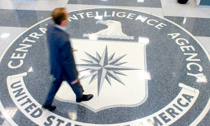 A man crosses the Central Intelligence Agency (CIA) logo in the lobby of CIA Headquarters in Langley, Va., on Aug. 14, 2008. (Saul Loeb/AFP via Getty Images)