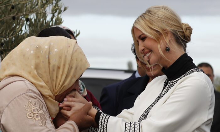 Farmer Aicha Bourkib kisses Ivanka Trump's hand, the daughter and senior adviser to President Donald Trump, in the province of Sidi Kacem, Morocco on Nov. 7, 2019. (Jacquelyn Martin/AP Photo)