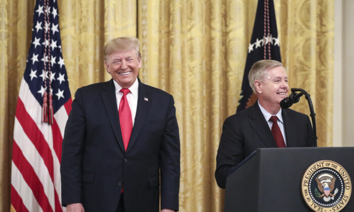 (L-R) Then-President Donald Trump looks on as Sen. Lindsey Graham (R-S.C.) speaks during an event about judicial confirmations in the East Room of the White House on Nov. 6, 2019. (Drew Angerer/Getty Images)