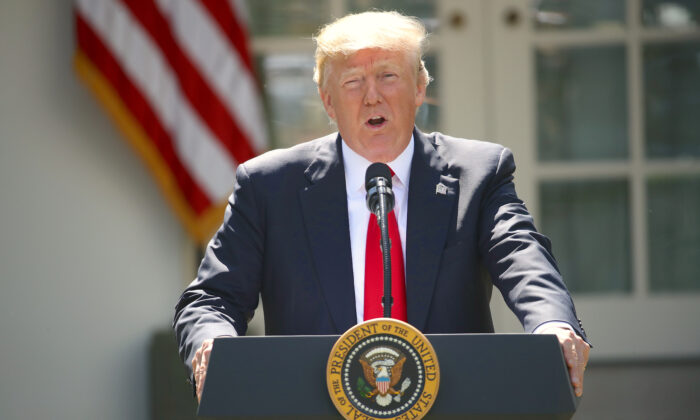 President Donald Trump announces his decision regarding the United States' participation in the Paris climate agreement in the Rose Garden at the White House June 1, 2017 in Washington, DC. Trump pledged on the campaign trail to withdraw from the accord, which former President Barack Obama and the leaders of 194 other countries signed in 2015. The agreement is intended to encourage the reduction of greenhouse gas emissions in an effort to limit global warming to a manageable level.