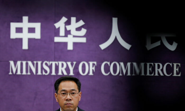 China's Ministry of Commerce spokesperson Gao Feng attends a news conference at the commerce ministry in Beijing on June 19, 2018. (Thomas Peter/Reuters)