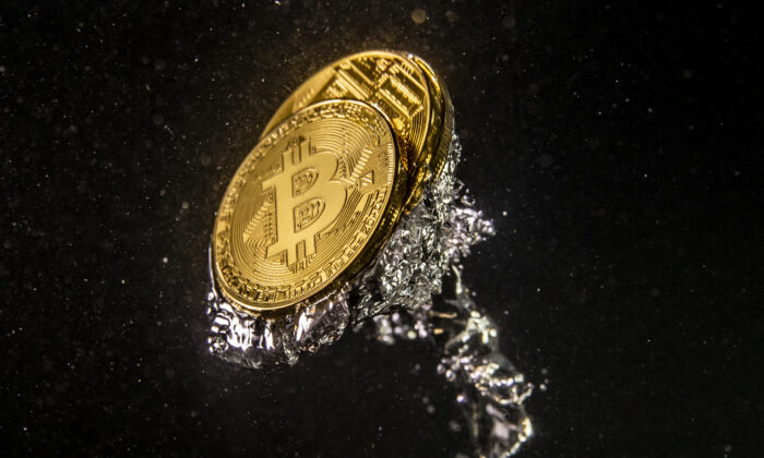 In this photo illustration a visual representation of the digital currency Bitcoin sinks into water in London, England on Aug. 15, 2018. (Dan Kitwood/Getty Images)