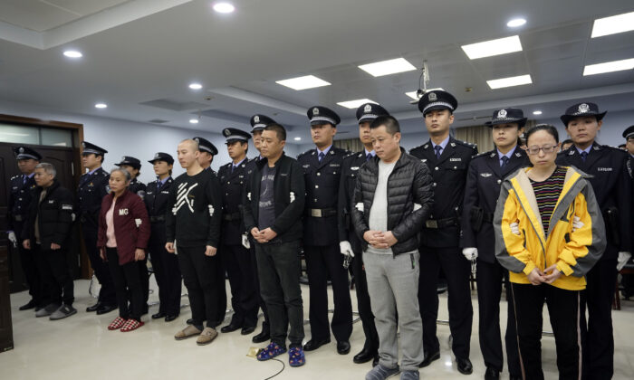 A trial continues as fentanyl drug traffickers are sentenced in court in Xingtai, north China's Hebei Province on Nov. 7, 2019. (Jin Liangkuai/Xinhua via AP)