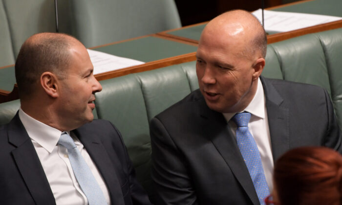 Treasurer Josh Frydenberg (L) and Home Affairs Minister Peter Dutton talk during a vote to suspend standing orders in the House of Representatives at Parliament House in Canberra, Australia, on Feb. 21, 2019. (Tracey Nearmy/Getty Images)