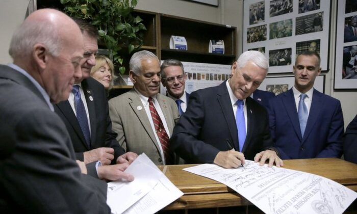 Vice President Mike Pence files the ticket of President Donald Trump and himself to be listed on the New Hampshire primary ballot, at the Secretary of State's office in Concord, New Hampshire, on Nov. 7. 2019. (AP Photo/Charles Krupa)
