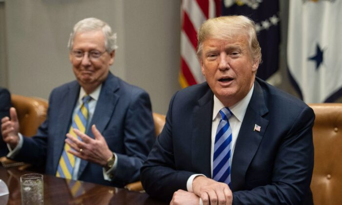 Senate Majority Leader Mitch McConnell (L) reacts as President Donald Trump speaks to the press before a meeting with Republican Congressional leaders at the White House in Washington, DC, on Sept. 5, 2018. (Nicholas Kamm/AFP via Getty Images)