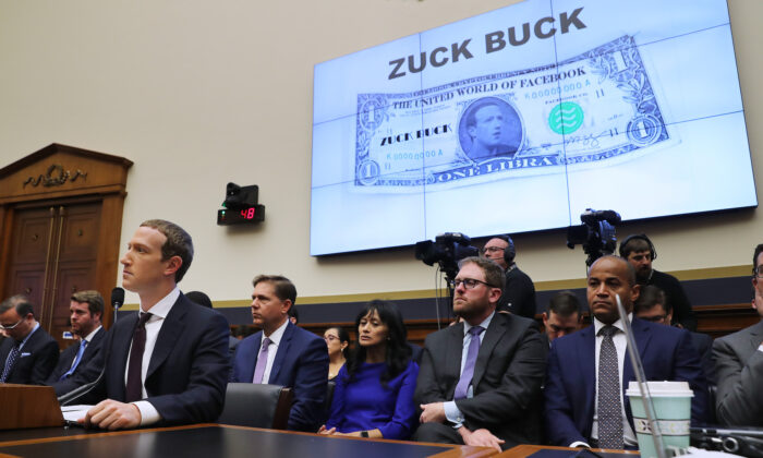 Facebook co-founder and CEO Mark Zuckerberg (L) testifies before the House Financial Services Committee in the Rayburn House Office Building on Capitol Hill October 23, 2019 in Washington, DC. Zuckerberg testified about Facebook's proposed cryptocurrency Libra, how his company will handle false and misleading information by political leaders during the 2020 campaign and how it handles its users' data and privacy. (Chip Somodevilla/Getty Images)