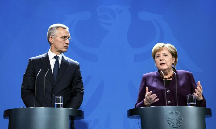 NATO Secretary General Jens Stoltenberg and German Chancellor Angela Merkel hold a joint a press conference at the Chancellery in Berlin, Germany, on Nov. 7, 2019. The two defended NATO after French President criticized the state of the military alliance, as did Prime Minister Justin Trudeau and U.S. Secretary of State Mike Pompeo. (Bernd von Jutrczenka/dpa via AP)