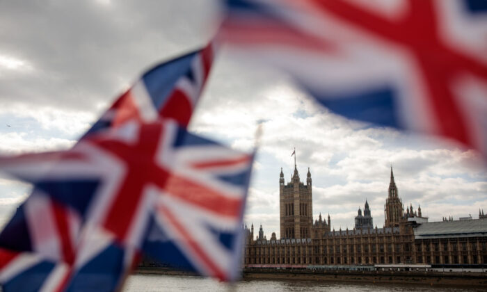 Union Jack flags flutter in the wind in front of the Houses of Parliament in London on March 26, 2019. (Jack Taylor/Getty Images)