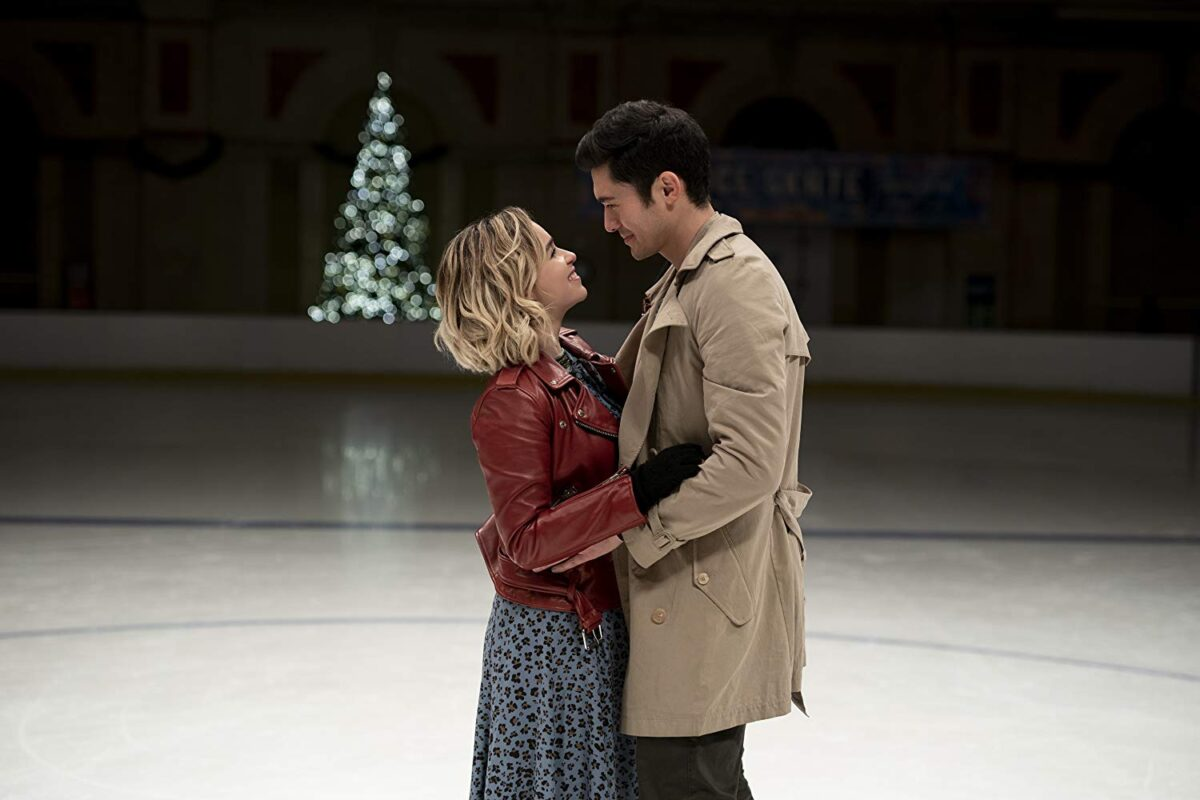 man and woman on ice rink
