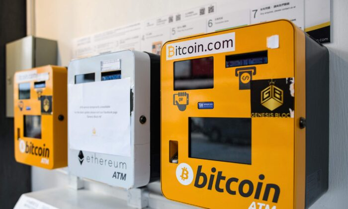 ATM machines (L and R) for digital currency Bitcoin are seen in Hong Kong on Dec. 18, 2017.  (Anthony Wallace/AFP via Getty Images)