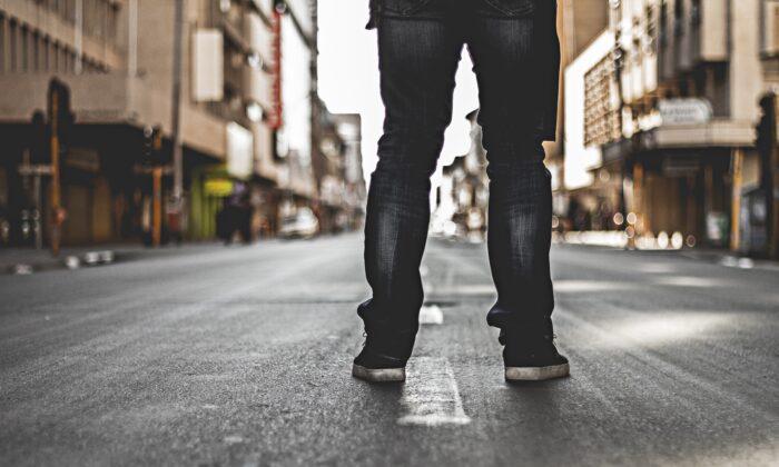 Illustration photo of man in urban setting. (Christian Spies/Unsplash)
