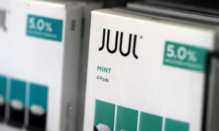 Packages of Juul mint flavored e-cigarettes are displayed at San Rafael Smokeshop in San Rafael, Calif., on Nov. 07, 2019. (Photo by Justin Sullivan/Getty Images)