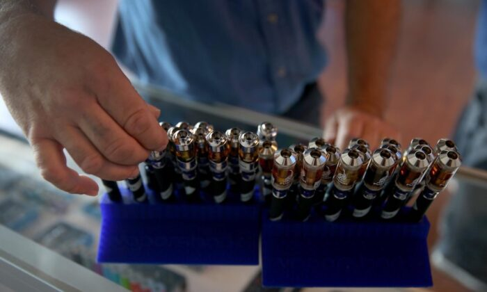 A customer picks from different flavors of electronic cigarette vapor. (Joe Raedle/Getty Images)