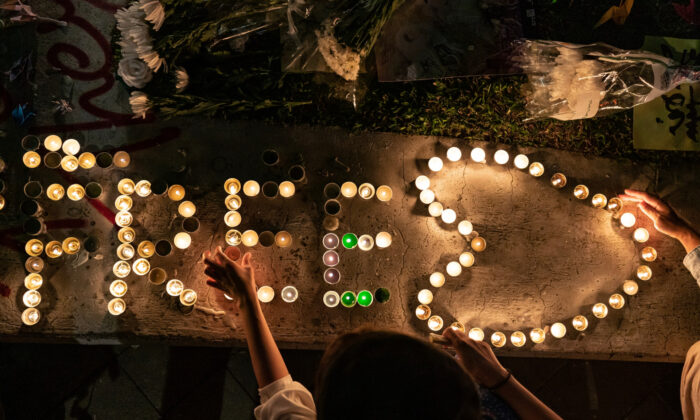 People light candles during a remembrance prayer in memory of university student Alex Chow in Hong Kong, on Nov. 9, 2019. (Anthony Kwan/Getty Images)