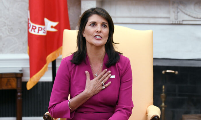 Nikki Haley, the U.S. ambassador to the United Nations at the time, speaks during a meeting with President Donald Trump in the Oval office of the White House in Washington on Oct. 9, 2018. (Olivier Douliery/AFP via Getty Images)