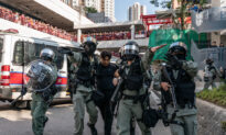 Hong Kong Protesters, Outraged by Death of College Student, Again Clash With Police