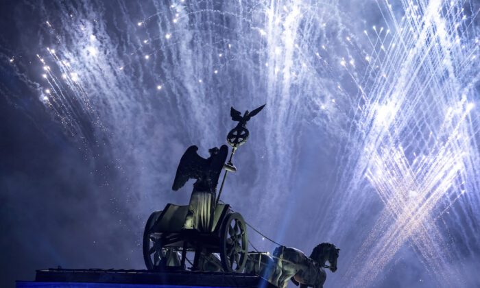 Fireworks are seen over the Brandenburg Gate as part of the 30th anniversary of the fall of the Berlin Wall in Berlin, Germany, Saturday, Nov. 9, 2019. (Bernd von Jutrczenka/dpa via AP)
