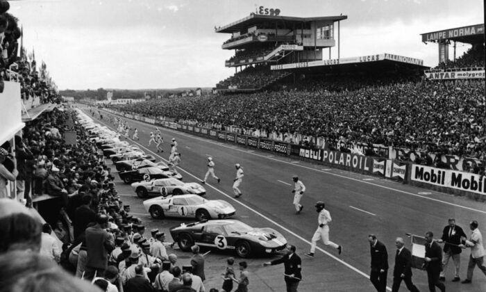 Drivers run to their cars at the 24 Hours Le Mans Auto race, France, on June 18, 1966. (Agence France Presse/Getty Images)