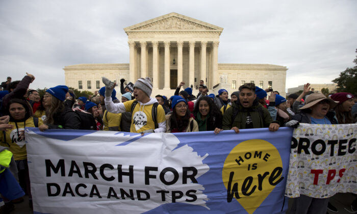 """Demonstrators arrive in front of the US Supreme Court during the """"Home Is Here"""" March for Deferred Action for Childhood Arrivals (DACA), and Temporary Protected Status (TPS) in Washington on Nov. 10, 2019.  JOSE LUIS MAGANA/AFP via Getty Images"""