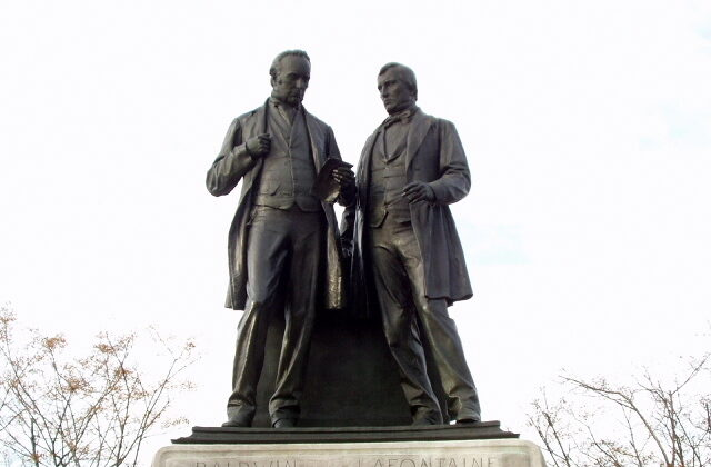 Statue of Robert Baldwin and Louis-Hippolyte LaFontaine on Parliament Hill in Ottawa. In the mid-1800s, the two politicians overcame adversity and worked together to bring responsible government to the Province of Canada. (Public Domain)