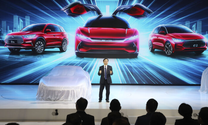 Wang Chuanfu, chairman and president of BYD Auto, the biggest global electric brand by sales volume, prepares to show the latest cars during the Auto Shanghai 2019 show in Shanghai on April 16, 2019. (Ng Han Guan/AP)